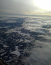 The aerial view of Norway with sun, lakes and clouds. Royalty Free Stock Photo