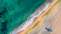 Aerial view of ocean waves and sand on beach Royalty Free Stock Photo