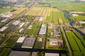 Aerial view over the amsterdam suburbs with canals houses fields and greenhouses holland Royalty Free Stock Photos