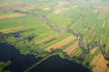 Aerial view over the lake amsterdam suburbs with canals houses fields and holland Royalty Free Stock Photo