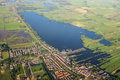 Aerial view over the lake amsterdam suburbs with canals houses fields and holland Royalty Free Stock Image