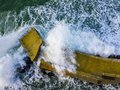 Aerial view of a pier with rocks. Pizzo Calabro pier, panoramic view from above. Broken pier, force of the sea. Power of Waves. N