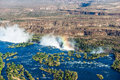 Aerial view of a rainbow over Victoria Falls Royalty Free Stock Photo