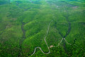 Aerial view of the rolling hills with green trees, roads and rivers. Royalty Free Stock Photo