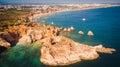 Aerial view of the scenic Ponta Joao de Arens beach in Portimao, Algarve, Portugal Royalty Free Stock Photo