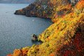 Aerial view of a sightseeing boat on autumn Lake Towada, in Towada Hachimantai National Park, Aomori, Japan