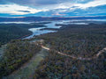Aerial view of Snowy River flowing into Lake Jindabyne at sunset Royalty Free Stock Photo