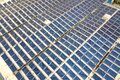 Aerial view of solar power plant with blue photovoltaic panels mounted of industrial building roof Royalty Free Stock Photo