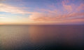 Aerial view of sunset over ocean. Nothing but sky, clouds and wa Royalty Free Stock Photo