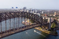 Aerial view of sydney harbor bridge bbridge and the city beyond Royalty Free Stock Photos