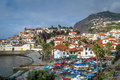 Aerial view to Camara de Lobos town and fishing boats harbor Royalty Free Stock Photo