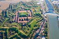 Aerial view of walls and bastions of modern six-star hexagon shaped fort Cittadella of Alessandria on winding river Tanaro Royalty Free Stock Photo