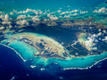 Aerial view of white lines of waves border caribbean islands viewed fro the air Stock Photography