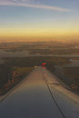 Aerial view from the window of a passenger airliner in flight at the clouds in the rays the rising sun. Royalty Free Stock Photo