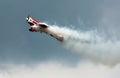 Aerobatics with smoke airplane flying figure Stock Photo