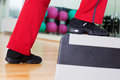 Aerobic step close up image of someone wearing red track pants black shoes and doing an Royalty Free Stock Photo