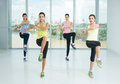 Aerobic step a group of young girls doing aerobics steps in the sport class Royalty Free Stock Photos