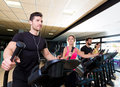 Aerobics elliptical walker trainer group at gym fitness workout Stock Photography