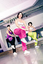 Aerobics girls young women in sport dress at an aerobic and zumba exercise Stock Images