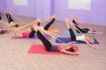 Aerobics hot pilates group with rubber bands in a row at fitness gym Royalty Free Stock Photos