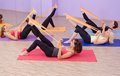 Aerobics hot pilates group with rubber bands in a row at fitness gym Stock Images