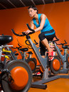 Aerobics spinning woman exercise workout at gym orange bikes Stock Images
