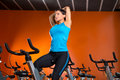 Aerobics spinning woman stretching exercises after workout at gym Royalty Free Stock Photography