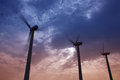 Aerogenerator windmills on dramatic sunset sky Royalty Free Stock Photos