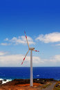 Aerogenerator windmills in front of ocean sea Stock Photo