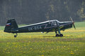 Aeroplane a black on green grass Royalty Free Stock Photos