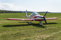 Aeroplane an landed on a green meadow Royalty Free Stock Photos
