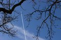 Aeroplane vapour trail a plane s shows it soaring high into the sky Stock Photography