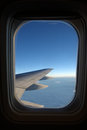 Aeroplane window an airplane with airplane wing Royalty Free Stock Image
