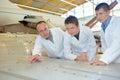 Aerospace engineers studying blueprint Royalty Free Stock Photo