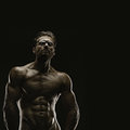 Aesthetic bodybuilding handsome athletic young man isolated on black Royalty Free Stock Images