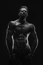 Aesthetic bodybuilding handsome athletic young man isolated on black black and white Royalty Free Stock Images
