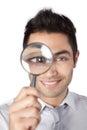 Affärsman holding magnifying glass Fotografering för Bildbyråer
