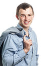 The affable young man guy with a jacket through a shoulder Royalty Free Stock Photos