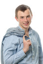 The affable young man guy with a jacket through a shoulder Stock Photography