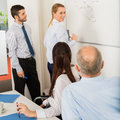 Affaires team planning strategy on whiteboard Photos stock