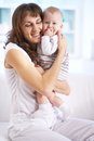 Affection portrait of happy women holding her small son and expressing Royalty Free Stock Photo