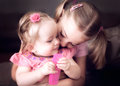 Affection two sister s showing to each other Royalty Free Stock Photo