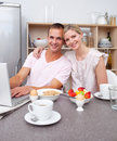 Affectionate couple having breakfast Royalty Free Stock Photos