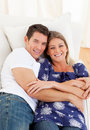 Affectionate couple lying down on sofa Stock Image