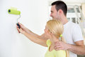 Affectionate couple painting wall young together Stock Photo
