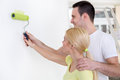 Affectionate couple painting wall young together Stock Image