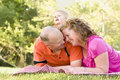 Affectionate Couple with Son in Park Royalty Free Stock Image