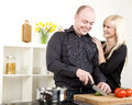 Affectionate couple preparing dinner Royalty Free Stock Photo