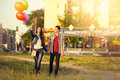 Affectionate couple walking in the amusement park together Royalty Free Stock Photo