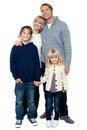 Affectionate family with children at studio young parents isolated over white Stock Photos